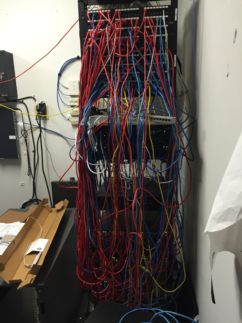 before server rack was cleaned up by installing new uniformed patch cables